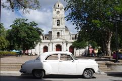 Classical car in front of historical church Stock Images