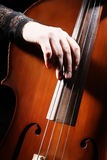Classical cello hand close up Stock Photos