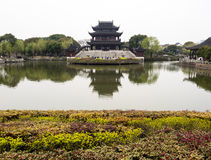 Classical Chinese garden with pavilion and pond Royalty Free Stock Image