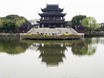 Classical Chinese garden with pavilion and pond Royalty Free Stock Photography