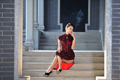 A classical Chinese woman dressed in cheongsam. Asian cultural elements, national costume,a classical Chinese woman dressed in cheongsam Royalty Free Stock Photography