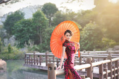 A classical Chinese woman dressed in cheongsam. Asian cultural elements, national costume,a classical Chinese woman dressed in cheongsam stock photos