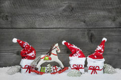 Classical christmas decoration in red, white and green on wooden Stock Images