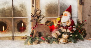 Classical christmas decoration: santa claus riding on reindeer b Stock Photography