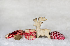 Classical christmas decoration with snow and wooden moose with r. Christmas decoration with snow and wooden moose with red gifts and balls Stock Photography