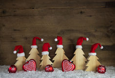 Classical christmas decoration with wood, santa hats on handmade Royalty Free Stock Photography