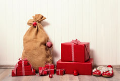 Classical christmas presents wrapped in red paper on white woode Royalty Free Stock Photos