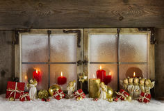 Classical christmas wooden window decoration with red candles an Stock Image