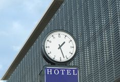 Classical clock in the inner city of Berlin in front of a modern facade. Classical clock in the inner city of Berlin in front of a modern metal facade Royalty Free Stock Photos