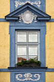 Classical colorful window with pediment in Prague Stock Photography