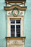 Classical colorful window with pediment in Prague. Czech Republic Royalty Free Stock Image