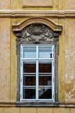 Classical colorful window with pediment in Prague Stock Photo