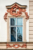 Classical colorful window with pediment in Prague Royalty Free Stock Photos