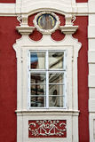 Classical colorful window with pediment in Prague Stock Photos