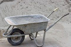 Classical concrete trolley, cement wheelbarrow Royalty Free Stock Photos