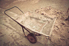 Classical concrete trolley, cement wheelbarrow Stock Photography