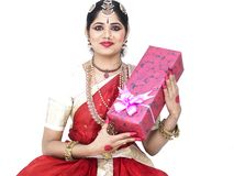 Classical dancer with a gift box Royalty Free Stock Image