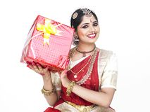 Classical dancer with a gift box Royalty Free Stock Images