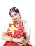 Classical dancer with a gift box Stock Images