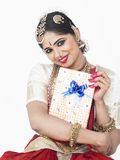 Classical dancer with a gift box Royalty Free Stock Photo