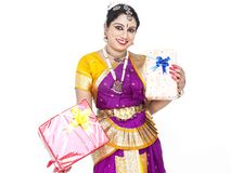 Classical dancer with a gift boxes Royalty Free Stock Images