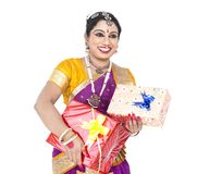 Classical dancer with a gift boxes. Beautiful female Bharathanatyam dancer of South India with gift boxes Stock Photos