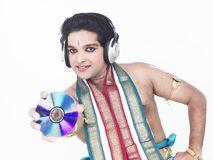 Classical dancer with headphones Stock Images