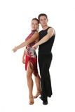 Classical dancing. The young man and the girl dancing the Latin American dance Stock Photography