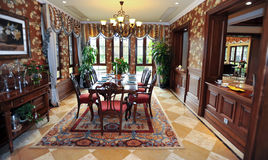 Classical dining room in a Villa. Wooden decorated.big carpet.red chairs Stock Image