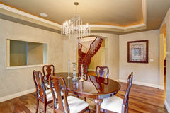 Classical dinning room with beautiful glass chandelier. Royalty Free Stock Image