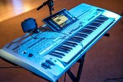 Classical electronical music keyboard view blue concert lights bokeh background musician. Classical electronical music keyboard view in blue concert lights bokeh Stock Photos