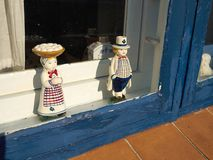 Classical European porcelain figurines in a window Stock Photography