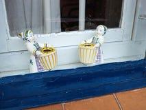 Classical European porcelain figurines in a window Stock Photo