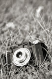 Classical film camera on the ground Stock Photos