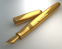 Classical fountain pen in gold finish Royalty Free Stock Photos