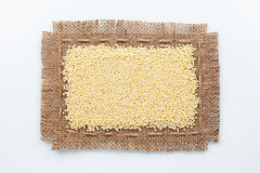 Classical frame made of burlap with grains of millet Royalty Free Stock Image