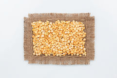 Classical frame made of burlap with grains of peas Royalty Free Stock Photos