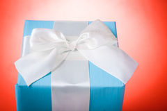 Classical gift box  over red background Royalty Free Stock Photos