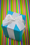 Classical giftbox on colored striped background Stock Photos