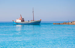 Classical Greek fishing boat in the blue sea Royalty Free Stock Images