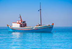 Classical Greek fishing boat in the sea Stock Photos