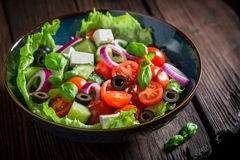 Classical Greek salad with lettuce, cherry tomatoes and feta cheese Stock Photography
