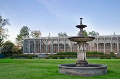 Classical greenhouse and fountain. Old greenhouse and fountain outside Racconigi castle, Italy Stock Images