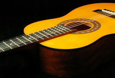 Classical guitar. Zoomed-in classical guitar on black background stock images