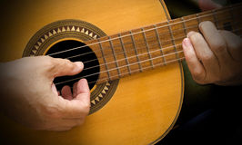 Classical Guitar. A Spanish guitar being played Royalty Free Stock Image
