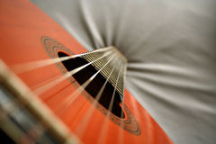 Classical guitar. Guitar standing on the head Royalty Free Stock Photo