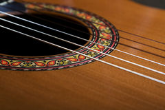 Classical guitar. Closeup image of rosette and nylon strings of classical guitar Stock Photography