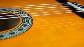 Classical guitar close-up of partial sound hole royalty free stock images