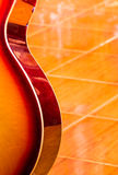 Classical Guitar. Detail of a classical guitar with warm shades Stock Image