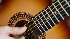 Classical guitar finger picking stock video footage